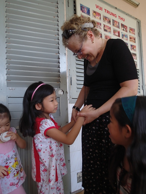 Pam, Rae and a super sweet little girl in Tam Binh.
